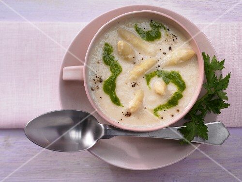 Creamy asparagus soup with parsley oil