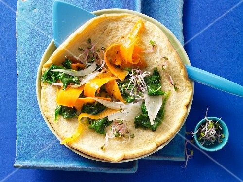 A foamy omelette with vegetables and beansprouts