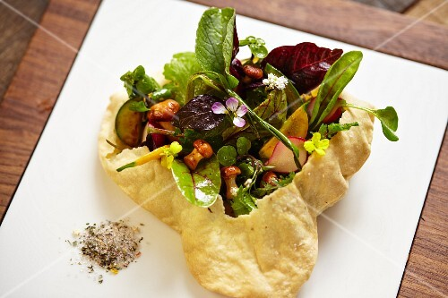 Strudel pastry pocket filled with salad, vegetables and mushrooms