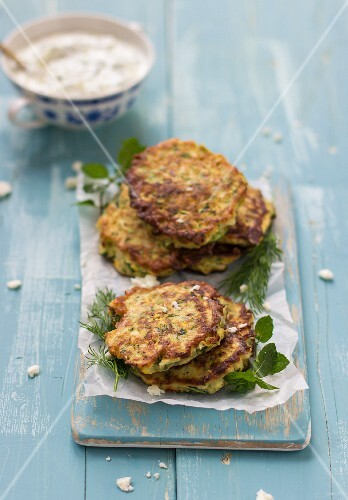 Zucchini fritters with feta, parsley and dill, served with tzatziki