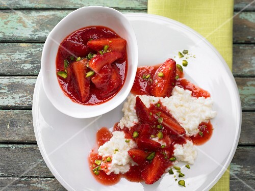 Strawberry ragout on a bed of creamed rice with chopped pistachios