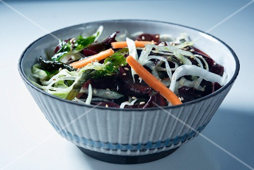 Asian seaweed salad with carrot in a serving bowl