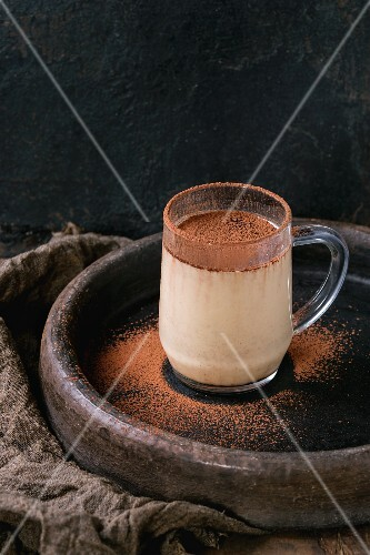 Coconut milk shake with chocolate and cocoa powder in a glass mark