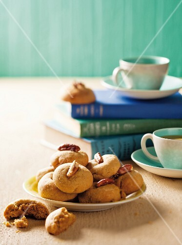 Ginger biscuits with pecan nuts served with tea