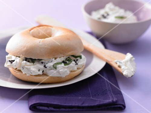 A sheep's cheese bagel with mint and cumin