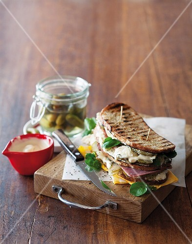 A toasted Reuben sandwich with pastrami, sauerkraut and Emmental cheese