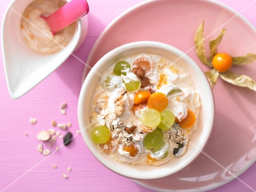 Sea buckthorn and quark muesli with grapes and physalis