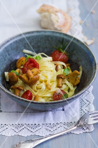 Tagliatelle with chanterelle mushrooms and cherry tomatoes