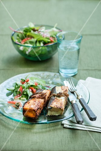 Fish parcels with cod and salmon served with Asian salad