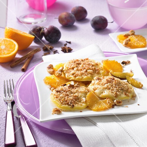 Powidltaschen (stewed plum pastries) with oranges, plums and nuts