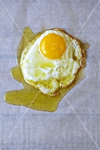 An egg fried in olive oil