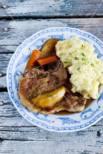Pork chop with apple sauce and crushed potatoes
