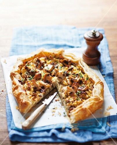 A puff pastry tart with mushrooms and ricotta