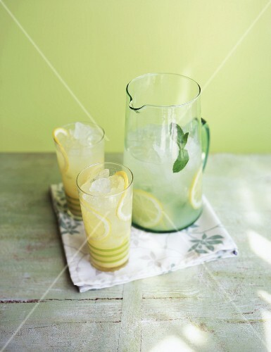 Lemonade in a carafe with two glasses
