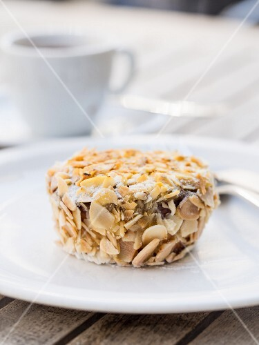 A gluten-free almond flour cake with flaked almonds