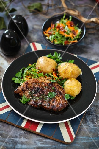 Grilled pork collar steak with new potatoes