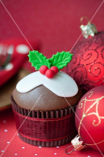 Festive cupcake with red Christmas baubles