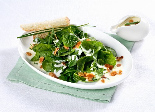 Baby leaf spinach with cheese sauce and flaked almonds