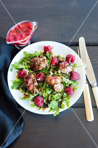 A rocket salad with raspberries, pan-fried chicken liver, flaked almonds and raspberry dressing