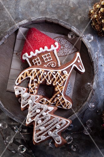 Christmas gingerbread biscuits (shaped like a Christmas tree, horse and house)
