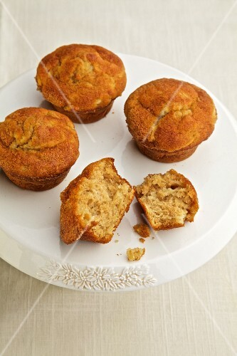 Cinnamon and apple muffins on a cake stand