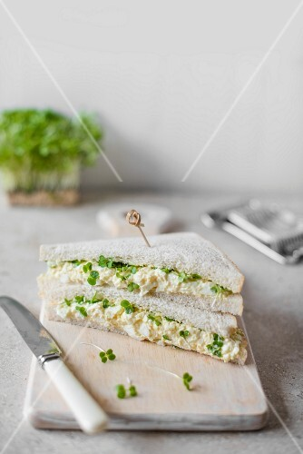 Egg and cress sandwiches on a chopping board