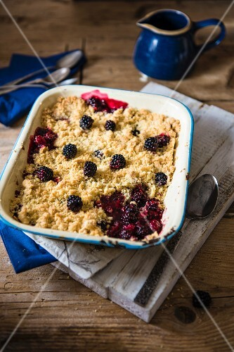 Blackberry and apple crumble in an enamel dish