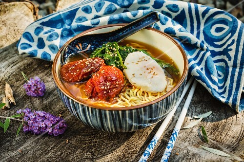 Japanese ramen soup with slow-roasted tomatoes and spinach