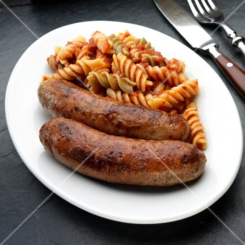 Two Italian sausages (salsiccia) with pasta tricolore