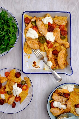 One-pot nachos with chicken, chorizo, jalapenos and cherry tomatoes
