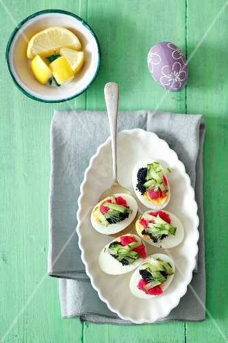 Eggs with caviar and cucumber for Easter