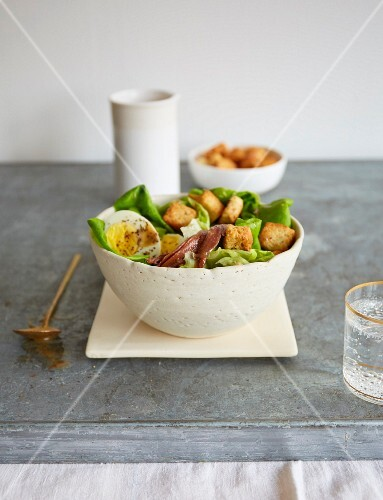 Caesar salad with anchovies, egg and croutons