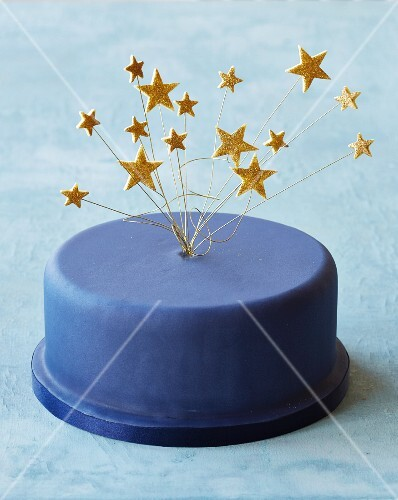A blue party cake with star decorations