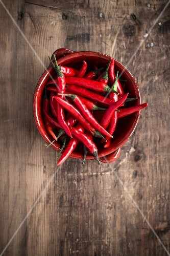 Fresh red chilli peppers in a ceramic bowl