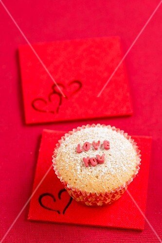 A cupcake with sugar letters spelling out 'LOVE YOU'