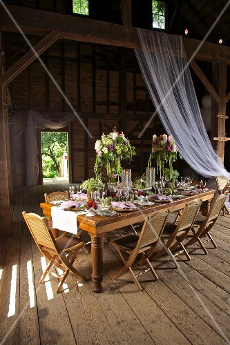 Festive table set in rustic style in barn