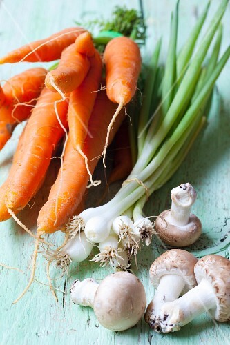 Carrots, spring onions and fresh organic mushrooms