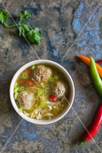 Asian soup with meatballs and chilli peppers