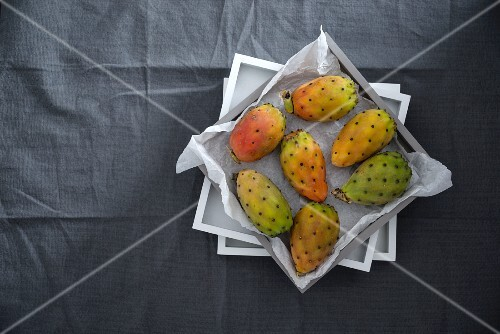 Fresh prickly pears in a box (Italy)
