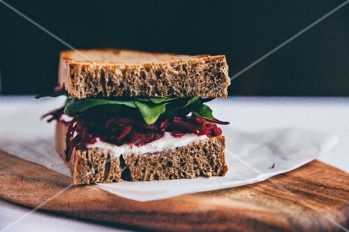 A toasted sandwich with beetroot and spinach