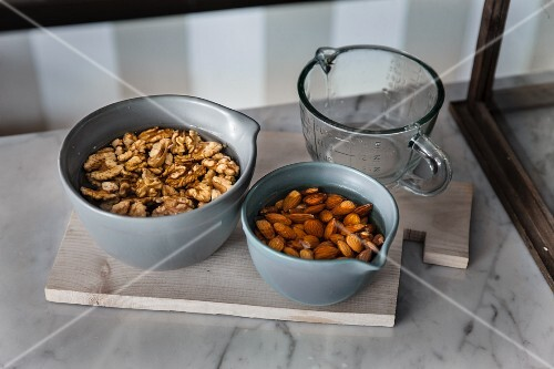 Walnuts and almonds being soaked in water (raw baking)