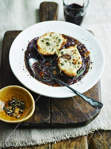 Rich red onion soup with grilled cheese on toast