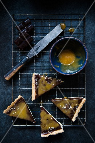 Four slices of chocolate and salted carmel tart (seen from above)