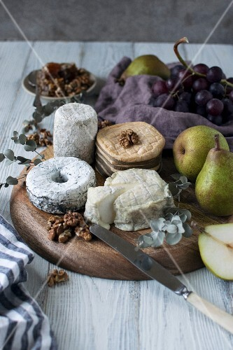 An arrangement of cheese with pears and nuts