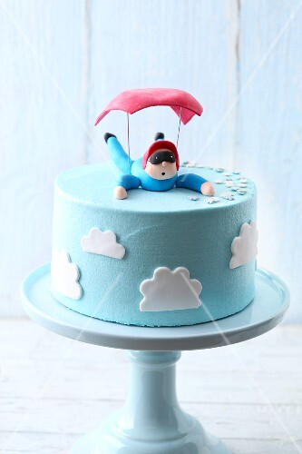 Light blue 'Parachute Landing' buttercream cake with marshmallow fondant