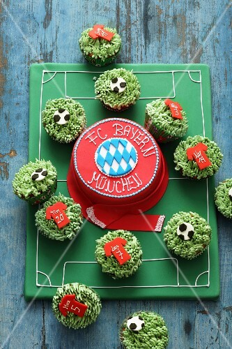 A fondant icing cake and cupcakes for football fans