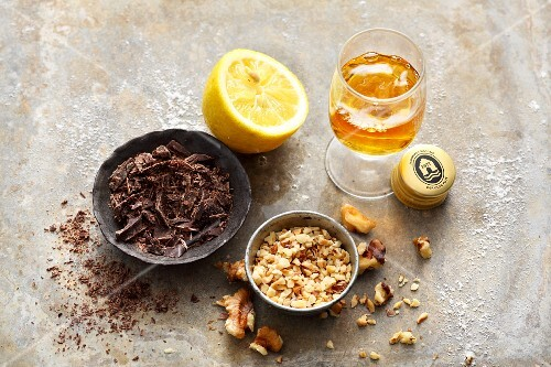 Baking ingredients: chocolate flakes, chopped walnuts, rum and lemon