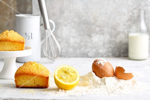 An arrangement of mini cakes and baking ingredients