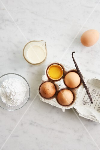 Ingredients for ice cream: cream, egg yolk, icing sugar and vanilla pod