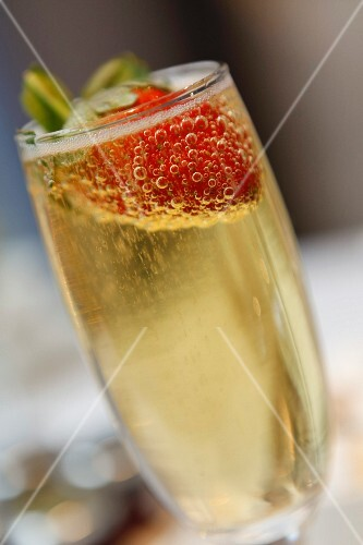 Champagne glass with a strawberry in the top